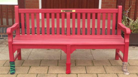 red memorial bench
