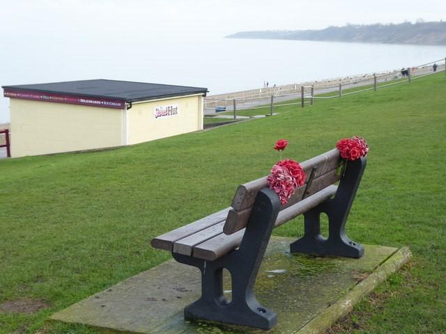 memorial bench overlooking sea front