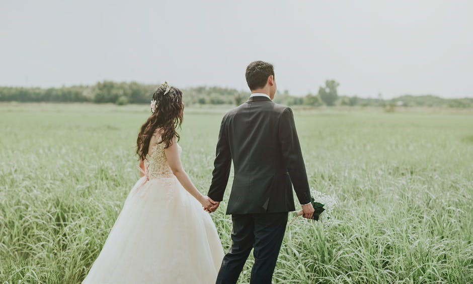 bride and groom on a field
