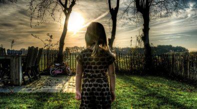 child watching the sunset