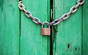 green shed door with padlock
