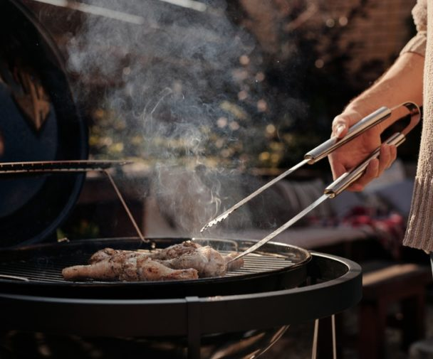 person cooking on a bbq